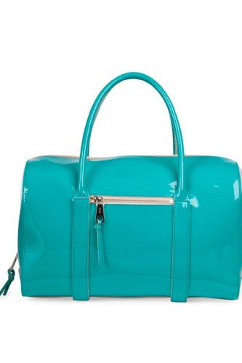 4f6188d3f2d7 Chloe s patent Madeleine bowling bag is as roomy as it is gorgeous.