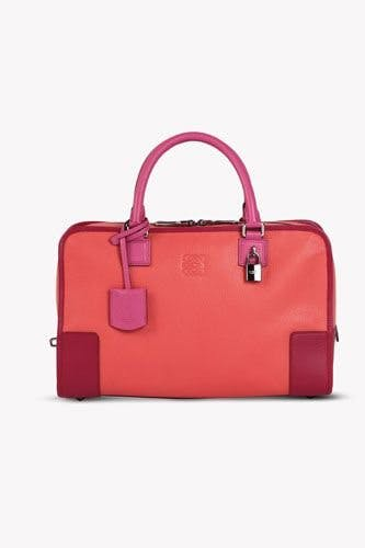 7f27244c3abfee Spain's premiere luxury brand Loewe was founded in 1846, and in 1975, they  launched the first flexible, unboxy handbag in sporty, unlined suede, ...