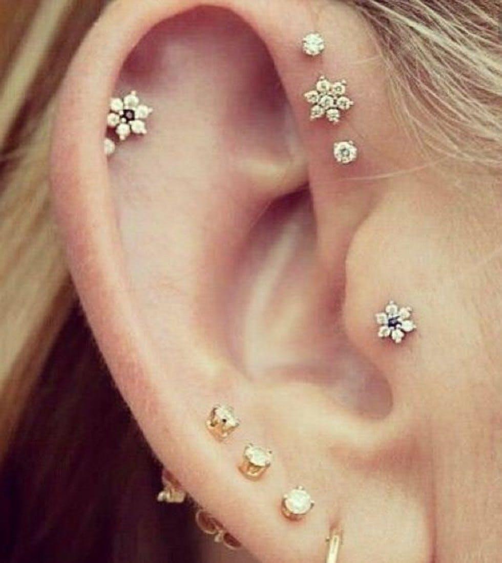 The 50 most unique multiple ear piercing ideas stylist flower studs ccuart Choice Image