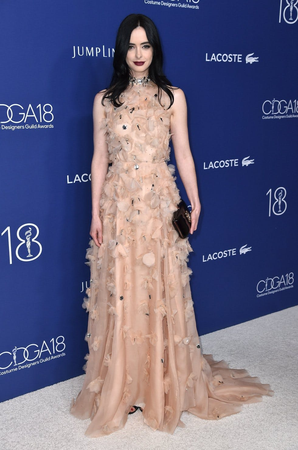 48e44dd88c6aa Actress Krysten Ritter contrasted the sweet feathers in her Lela Rose gown  with a dark
