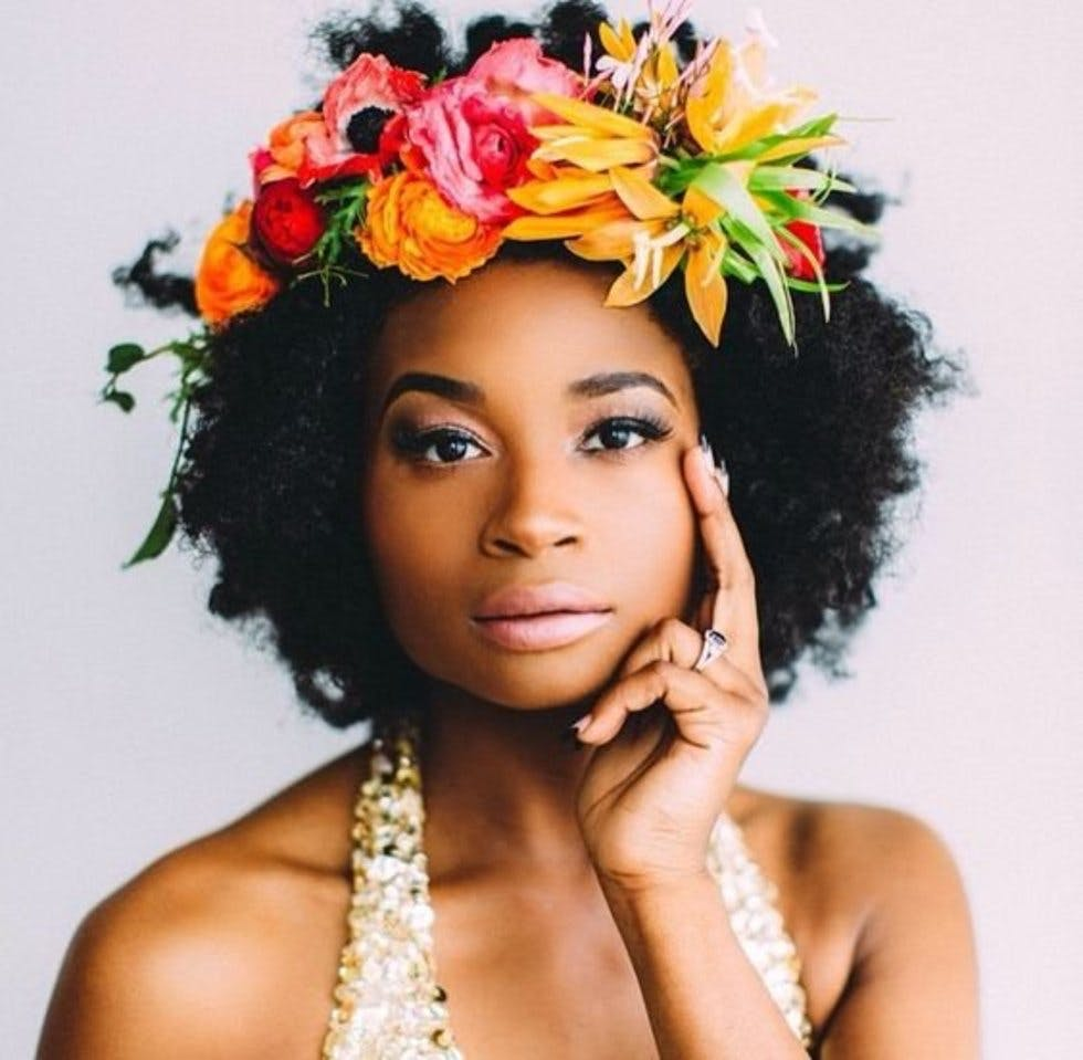 Simple and stunning ways to wear flowers in your hair stylist tropical hued flower crown izmirmasajfo