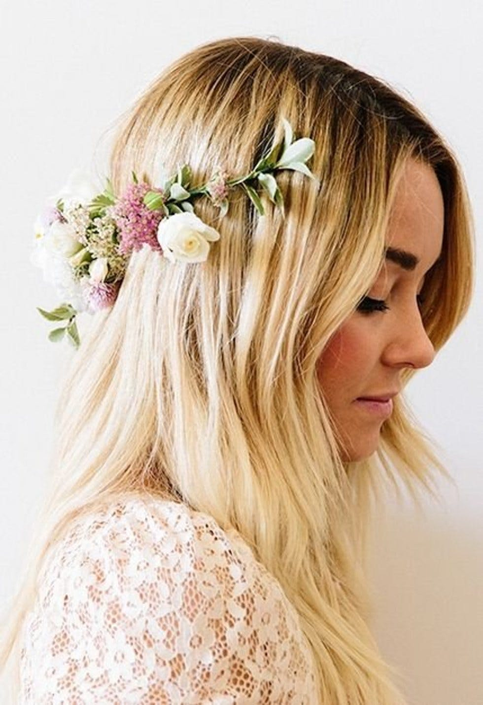 Simple and stunning ways to wear flowers in your hair stylist loose locks with a backwards flower crown izmirmasajfo