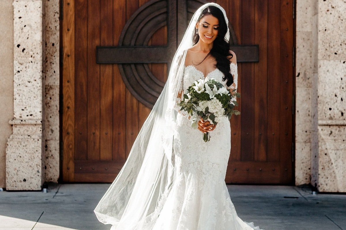 A bride walking outside the church on her wedding day