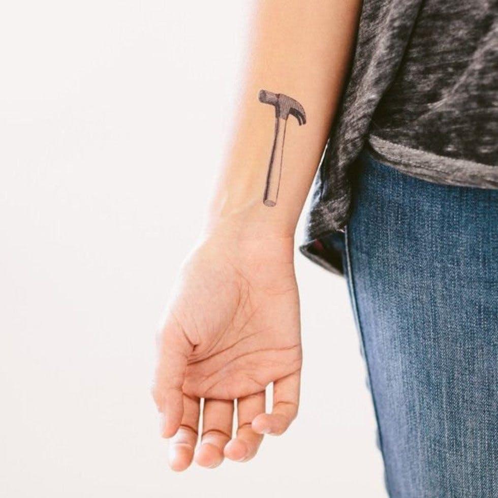 Woman Symbol Tattoo