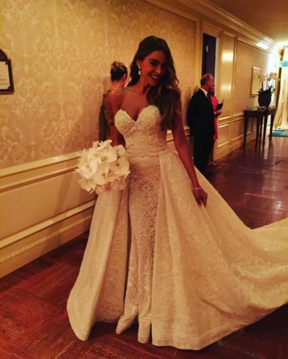 d8fe1616d14 The bride s custom Zuhair Murad Couture gown was nothing short of  spectacular with hand-embroidered detailing and a dramatic detachable skirt.