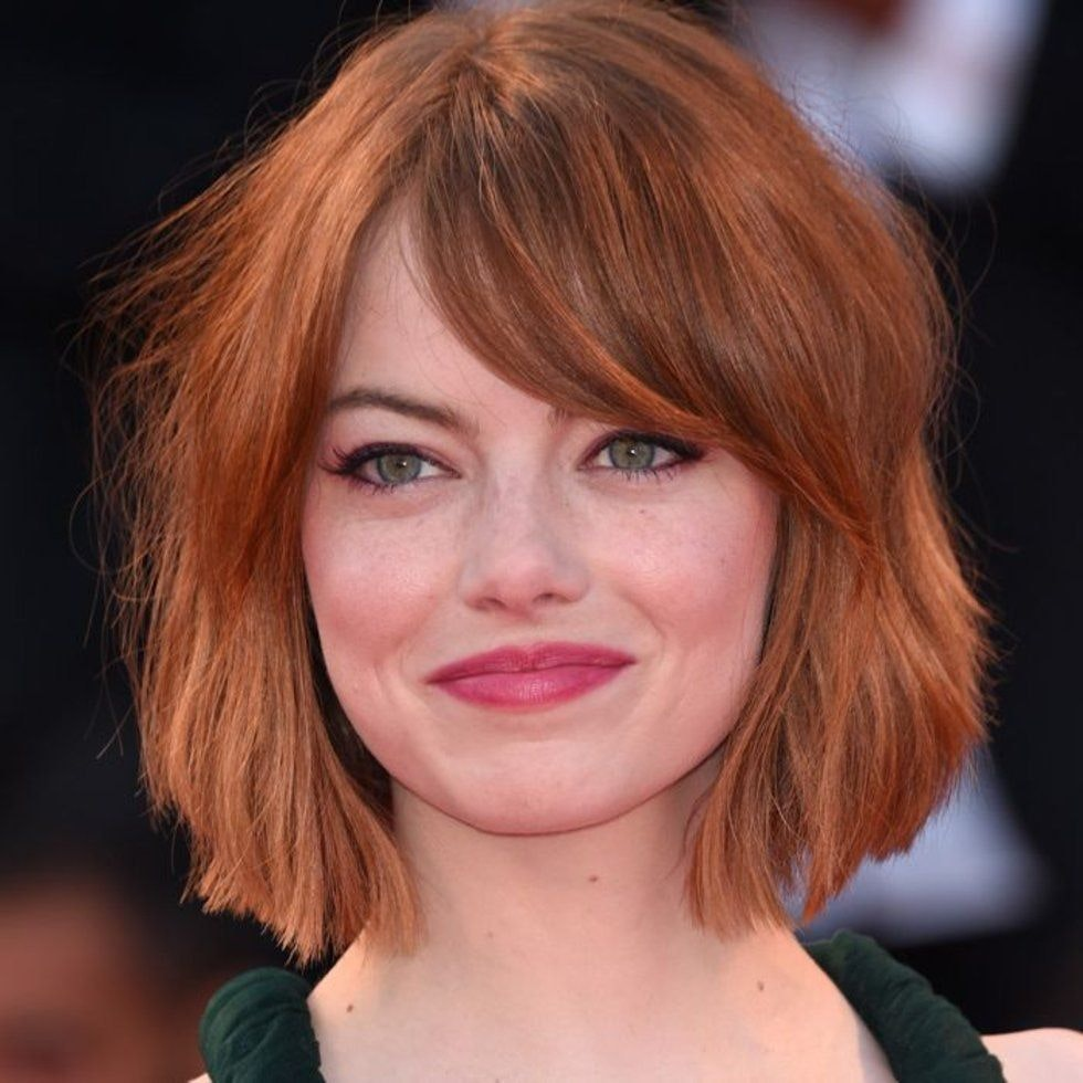 emma stone messy facial photo