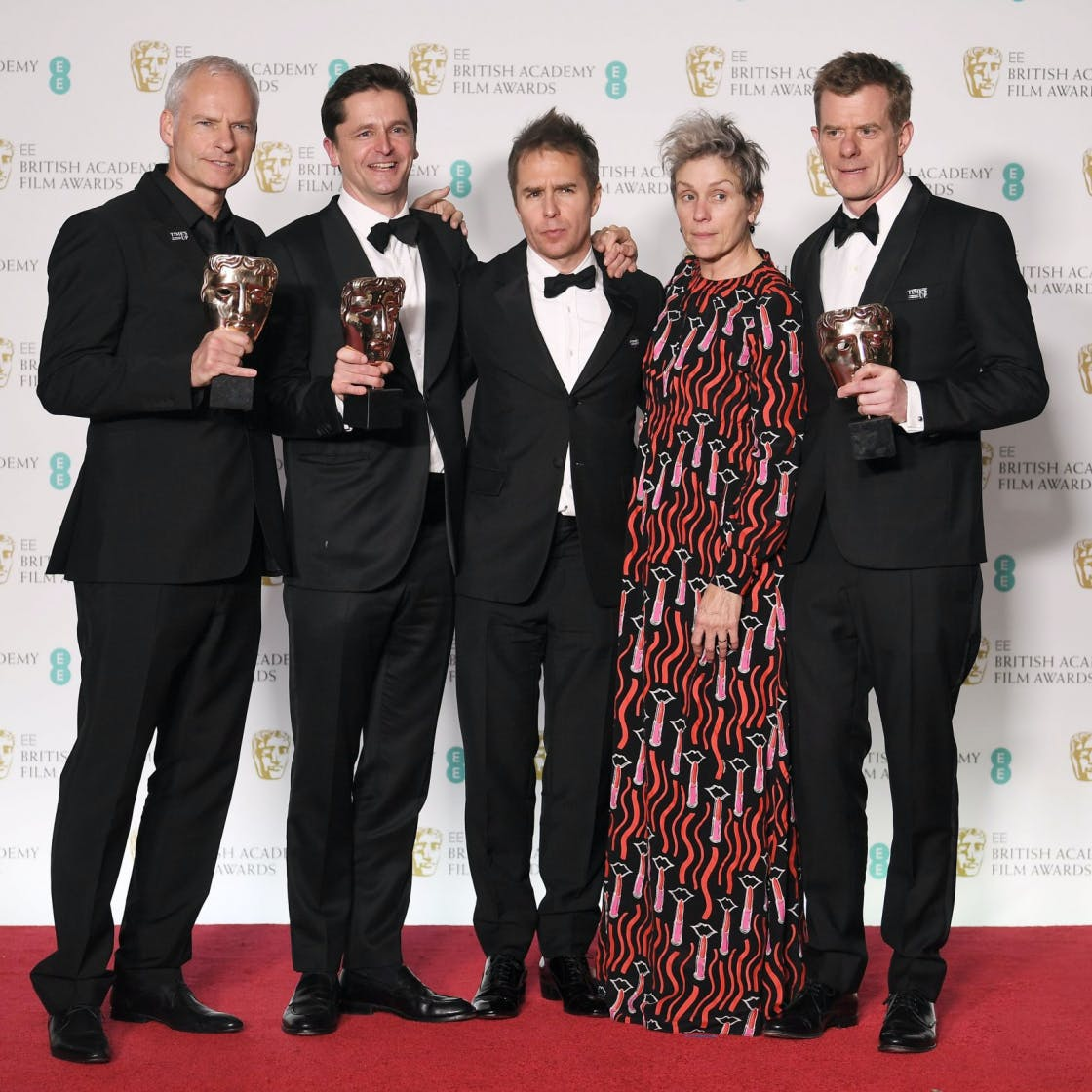 Frances mcdormand brilliantly explains why she wore that sam rockwell frances mcdormand martin mcdonagh graham broadbent and pete czernin at the 2018 baftas malvernweather Images