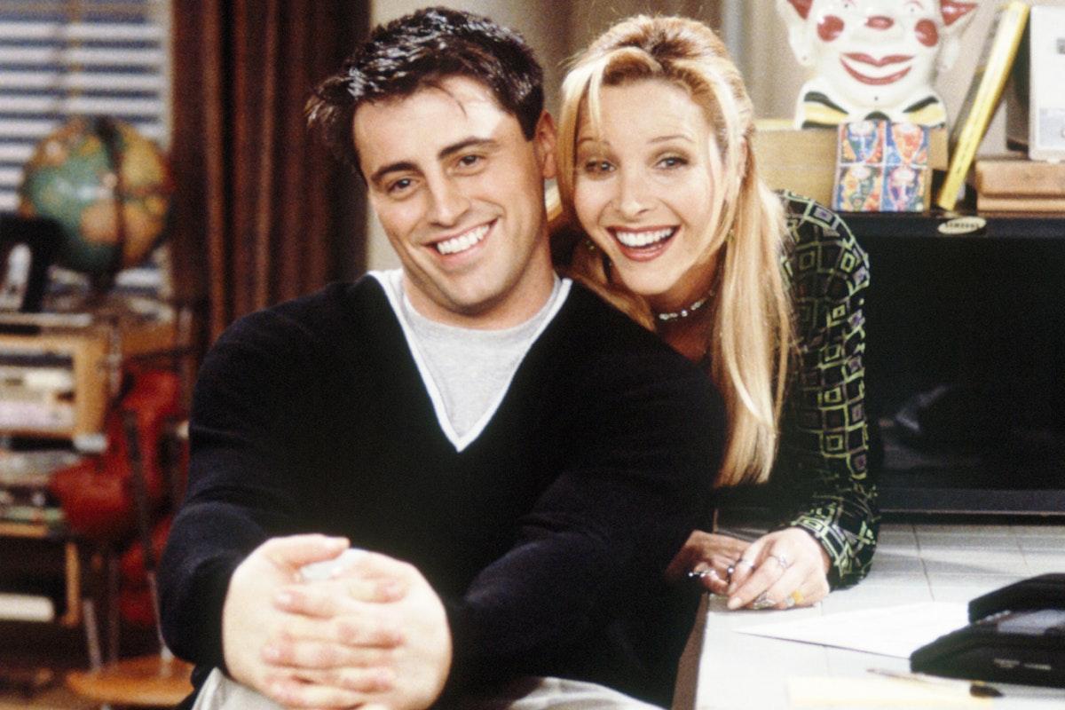 Matt LeBlanc and Lisa Kudrow hugging on the set of Friends