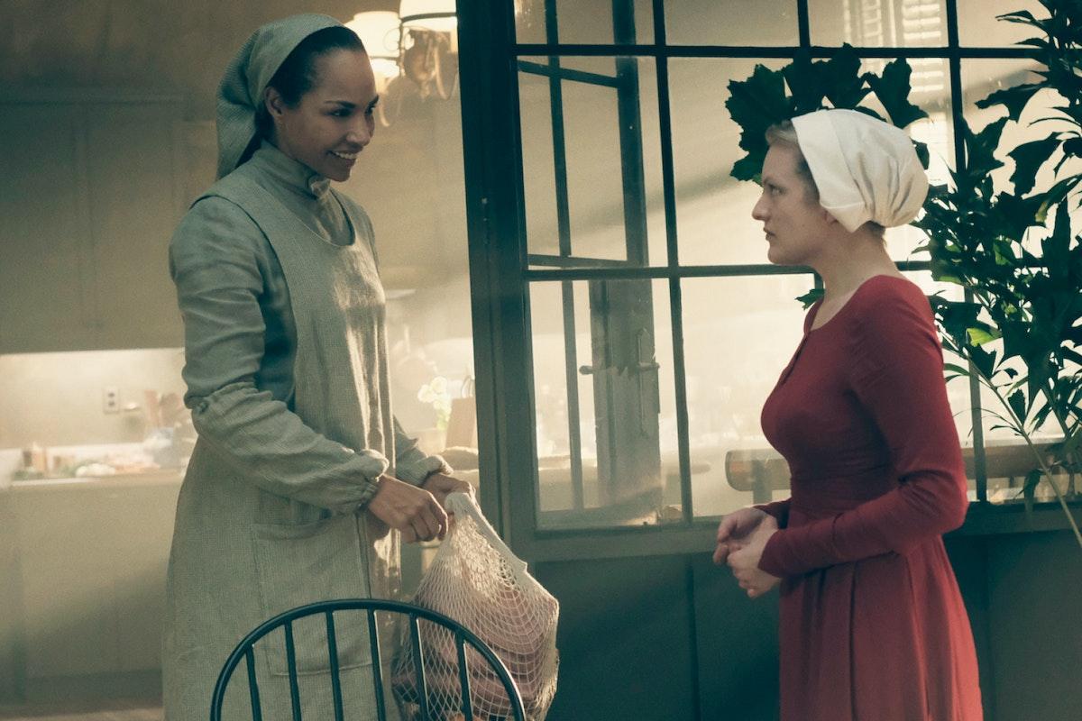 Rita (Amanda Brugel) and Offred/June (Elisabeth Moss) in The Handmaid's Tale