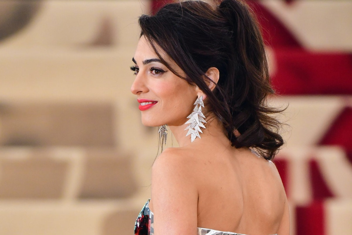 NEW YORK, NY - MAY 07: Amal Clooney attends the Heavenly Bodies: Fashion & The Catholic Imagination Costume Institute Gala at The Metropolitan Museum of Art on May 7, 2018 in New York City. (Photo by James Devaney/GC Images)