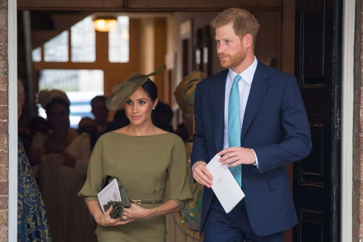 Prince Harry and Meghan Markle attend the royal christening of Prince Louis