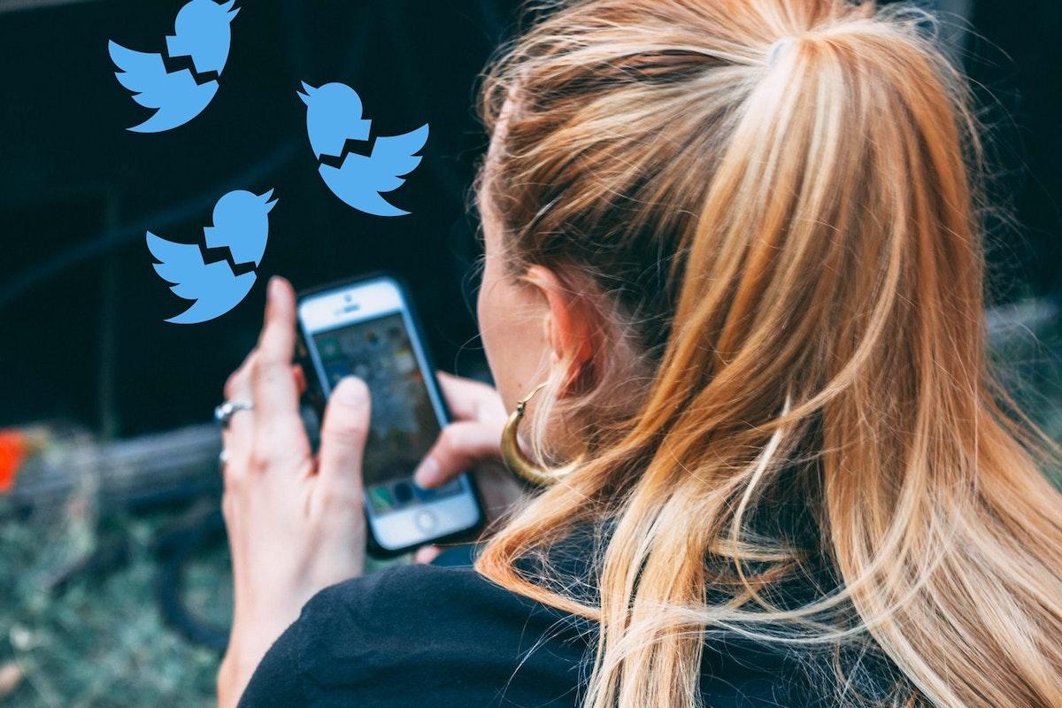 Woman Tweeting on phone