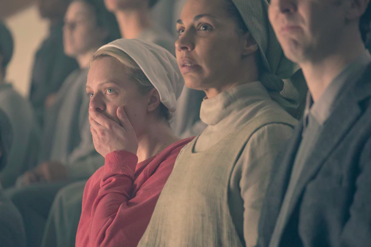 June (Elisabeth Moss) reacts to execution in Postpartum, The Handmaid's Tale