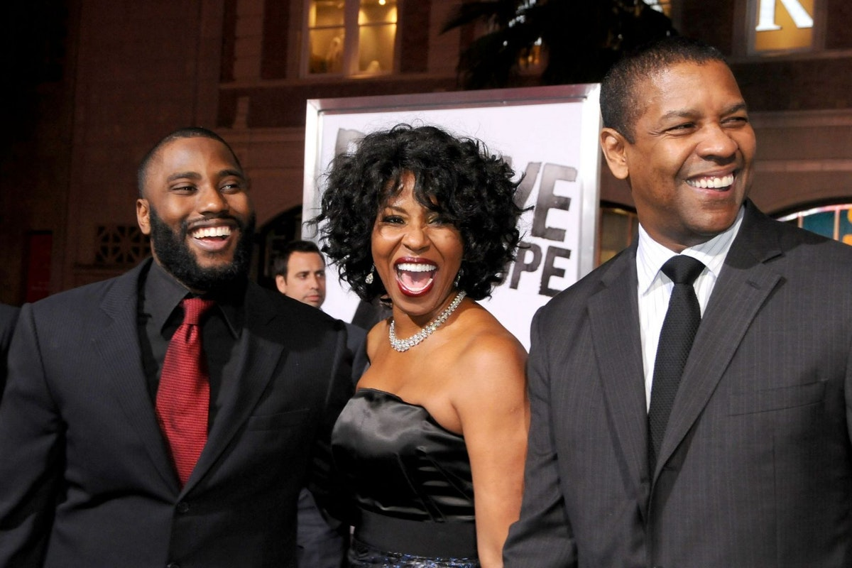 People: John David Washington, Pauletta Washington, Denzel Washington at Los Angeles premiere of The Life of Eli