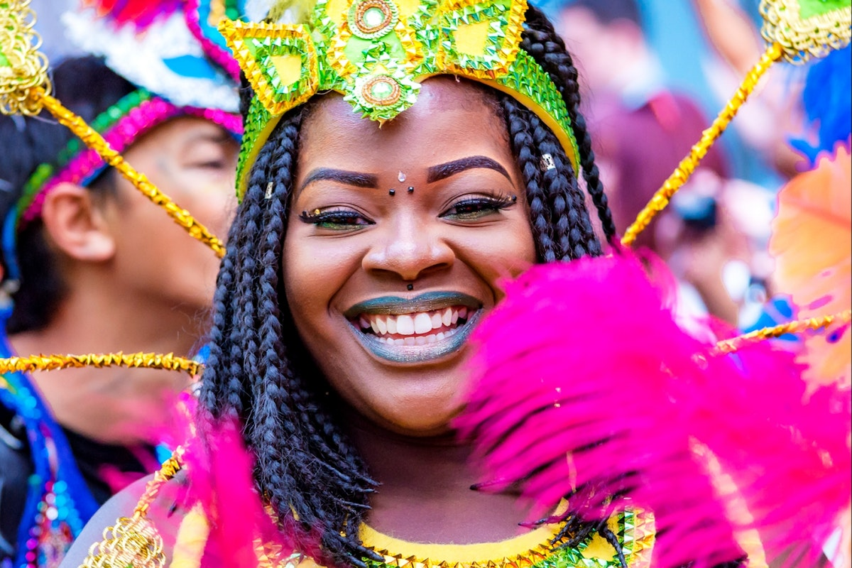 A woman smiles at Notting Hill Carnival
