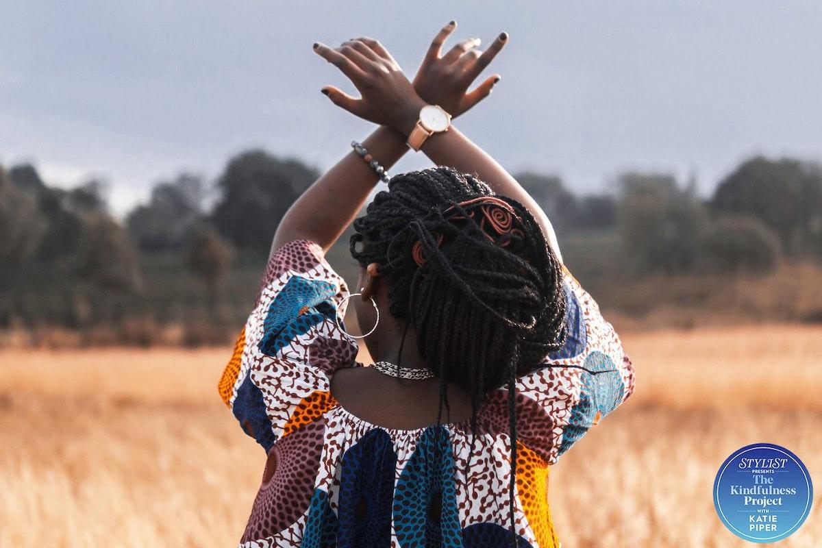 Woman dancing in a cornfield
