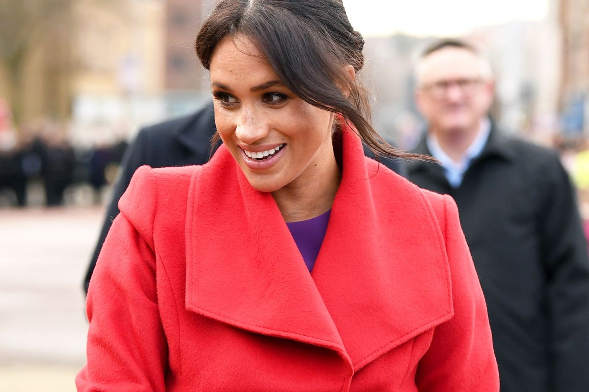 Meghan Markle in a red coat