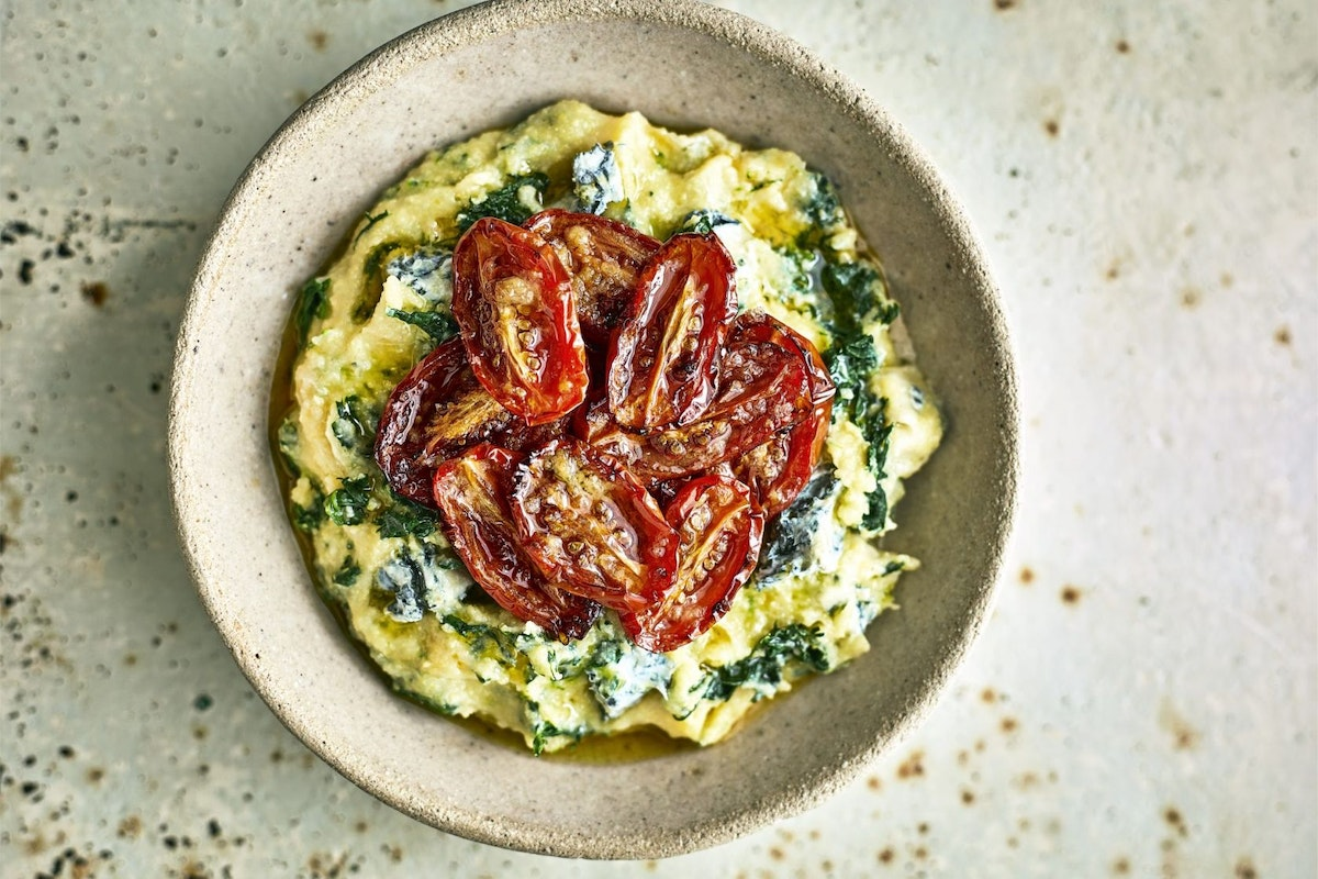 Spinach and blue cheese polenta with slow-roasted tomatoes recipe