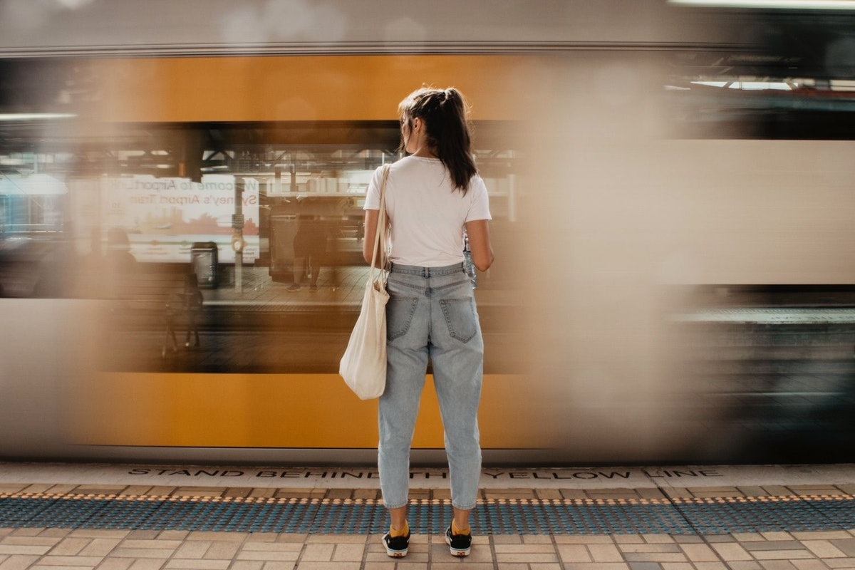 A woman stands at a train station in Sweden