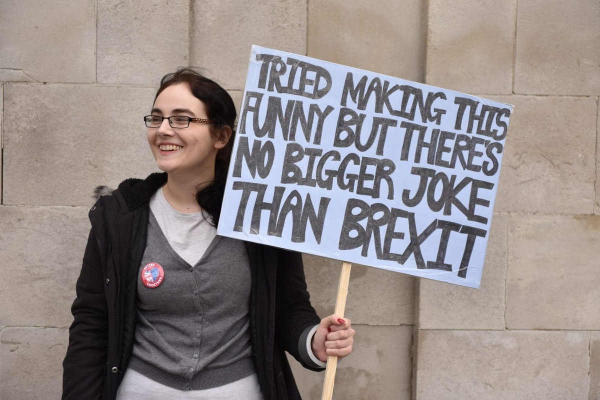 A woman holds an anti-Brexit sign at the Put It To The People march in London
