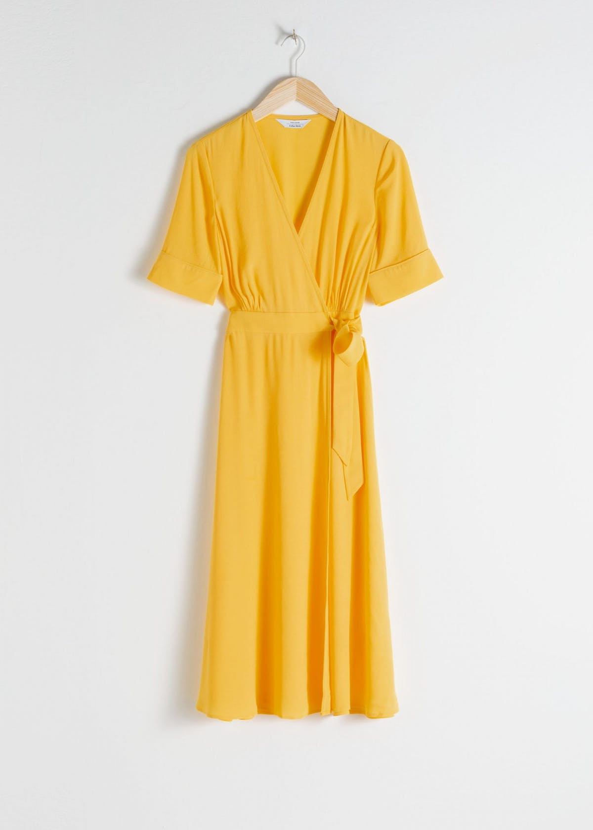 14ac19ac87a67 The wrap dress is the universally flattering style that suits practically  everyone. We ll just call it a hero frock