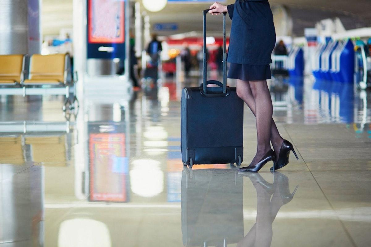 A flight attendant wearing heels